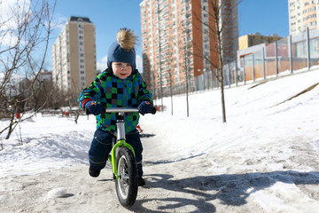 Boy riding on balance bike
