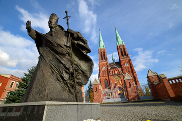 Fototapeta Statue of John Paul II against the background of the cathedral (Rybnik, Poland) obraz