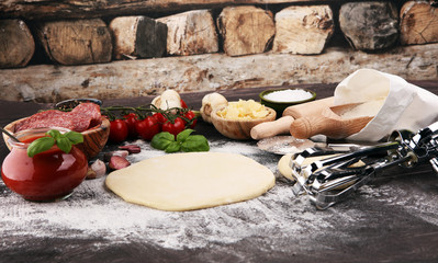 Fresh original Italian raw pizza preparation with fresh ingredients