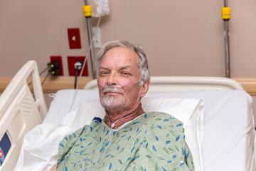 Elderly Man in Hospital Bed