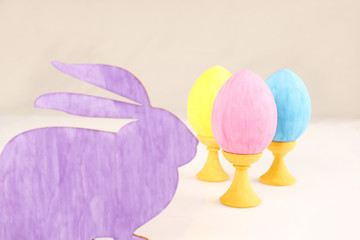 Close-up silhouette of the rabbit with colorful Easter eggs