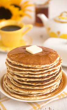 A Stack of Fresh Buttermilk Pancakes with Butter and Syrup