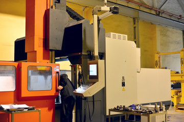 The cnc operator performs the replacement of the cutting tool