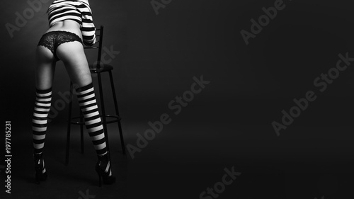 Y Young Beautiful Back Women With And Striped Stockings In Dark Background Fashion Studio