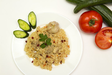 tasty plov rice and meat with vegetables