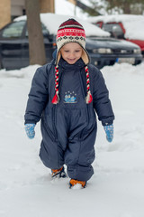 the boy is walking in the snow
