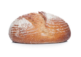 Freshly baked  loaf of bread with flour on white