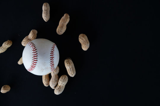 Baseball and ballpark peanuts isolated on black background