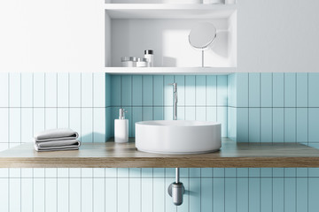 Sink in a blue and white bathroom interior