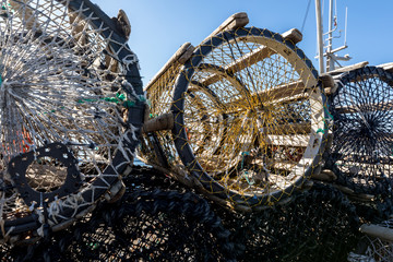 Close up photo of different crab traps on land, in the small fishing village Lista, Norway