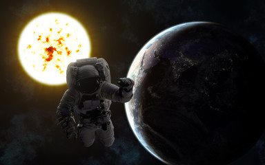 Astronaut. Sun and Earth. Image in 5K resolution for desktop wallpaper. Elements of the image are furnished by NASA