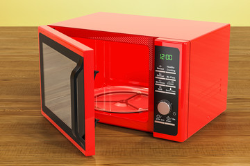 Red microwave on the wooden table. 3D rendering