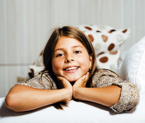 little cute brunette girl at home interior happy smiling closeup