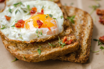 Eggs and fried wholemeal bread, breakfast.