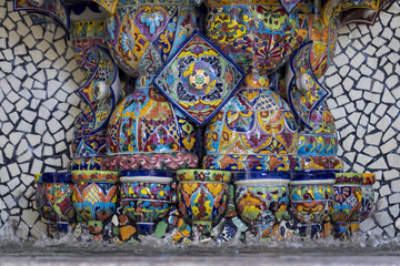 Mexican talavera style pottery used in altar and fountain. This colorful handmade maiolica have a blurred appearance as they fuse slightly into the glaze. Vibrant colors and unique designs in each one