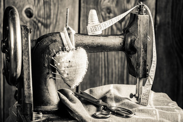 Old sewing machine with cloth, scissors and threads