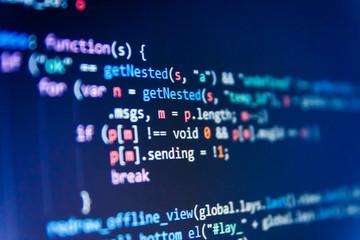 WWW software development. Notebook closeup photo. Closeup of Java Script, CSS and HTML code. Software engineer at work. Big data storage and cloud computing representation.