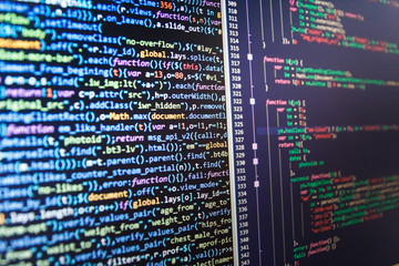Abstract IT technology background.  Desktop PC monitor photo. Abstract screen of software. Programming code. Hacker api text on the computer screen. Software development.