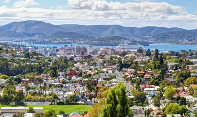 Aerial view of Hobart City. Large cruise ship is docked over horizon. Tasmanian Island. Australia.