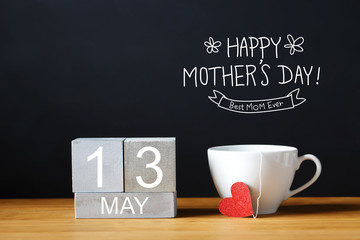 Mothers Day message with coffee cup with wooden blocks