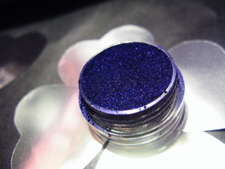Macro photo violet blue eye shadow pigment glitter gloss cosmetic make up