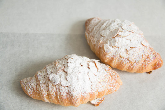 almond croissant on white paper