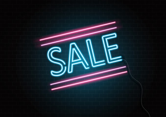 Neon sale sign on brick wall