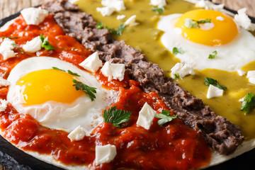 huevos divorciados, fried eggs on corn tortillas with two salsas macro, mexican food