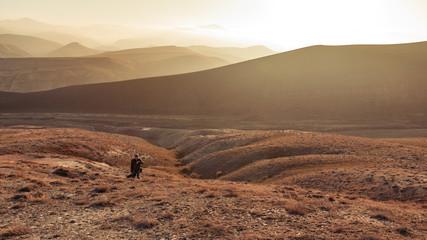 Traveler climbs to the mountain peak