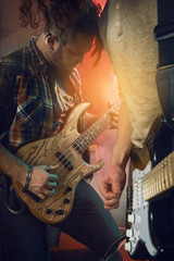 Guitarist and bass player play solo.