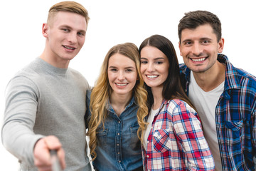 The four friends make a portrait selfie on the white background