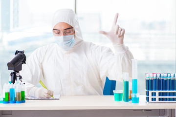 Young chemist pressing virtual buttons in lab