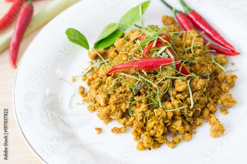 Pork Chops stir fried with spices curry strew with kaffir