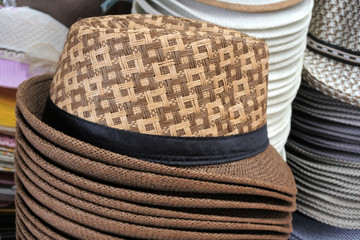 Retro style unisex straw hats on display in the market