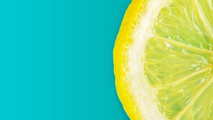 Flat lay picture of macro fresh slice of  lemon on cyan background