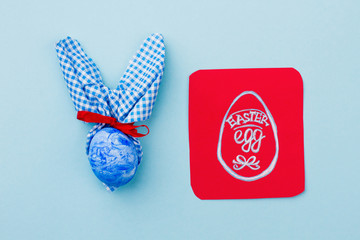 Easter rabbit and picture of Easter egg. Preparation for Easter holidays. Easter holidays creativity.