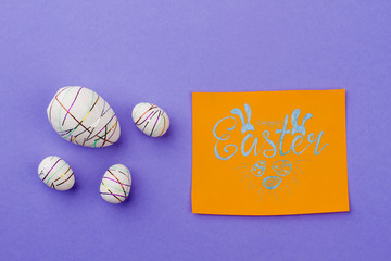 Happy Easter card and festive eggs. Styrofoam decorative eggs and card with text happy Easter. Congratulation with Easter holidays.