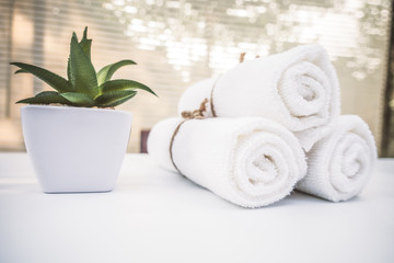 Beautiful spa composition white towel on wooden table.