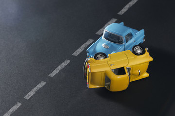 Traffic accident by toy cars.