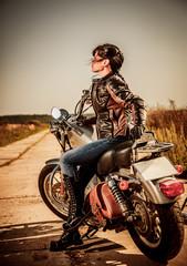 Wall Mural - Biker girl on a motorcycle