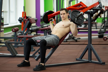 Man doing chest exercises on vertical bench press machine