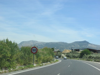 Speed limit sign on scenic highway in Spain
