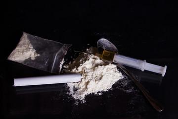 Hard drugs and syringe that causes addiction