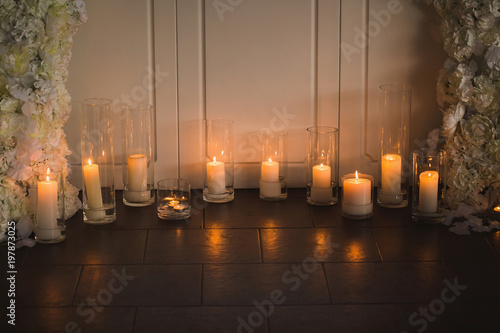 Vases With Candles Stand For Wedding Ceremony