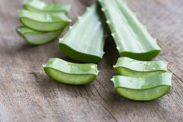fresh leaf and sliced of aloe vera on wood