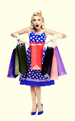 woman in pin-up style holding shopping bags