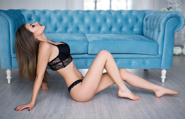 Attractive girl in a sexy black lingerie
