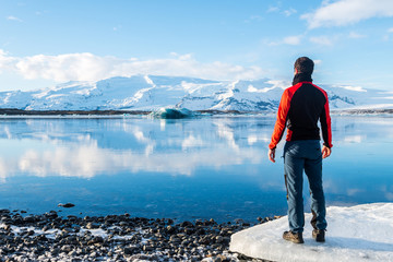 adventurer resting at jokulsarlon glacier, iceland