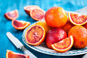 Sliced and whole fresh ripe juicy sicilian blood oranges