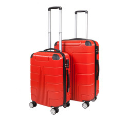Red suitcase isolated on white background. Polycarbonate suitcase isolated on white. Red suitcase.